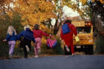 Kids running towards bus